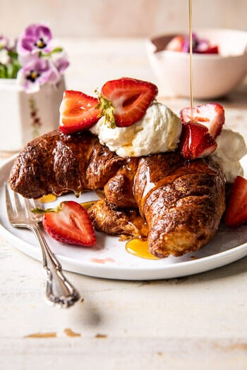 Baked Strawberry and Cream Stuffed Croissant French Toast.